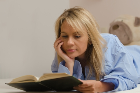 young beautiful woman is reading a book