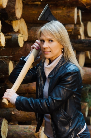 Young pretty woman with huge  axe photo