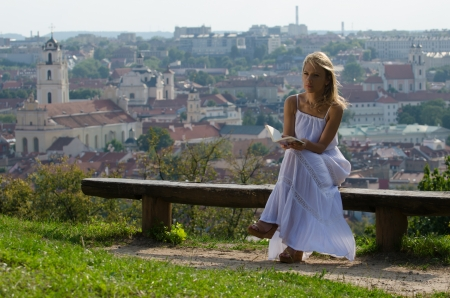 young woman reading book in Vilnius, Lithuania
