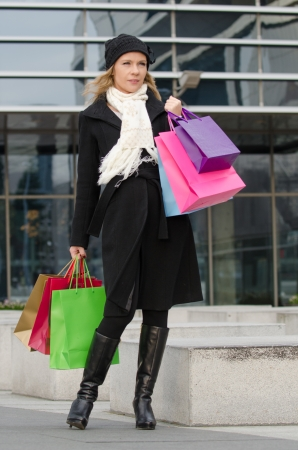 Young woman with shopping bags in Vilnius, Lithuania
