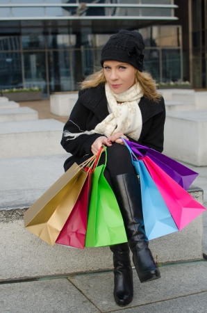 Young woman in black with shopping bags photo
