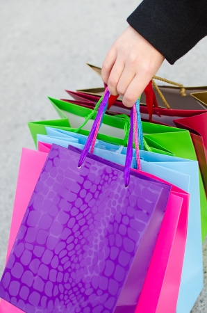Arm of young woman with shopping bags photo