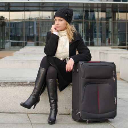 young woman with a travel suitcase Stock Photo
