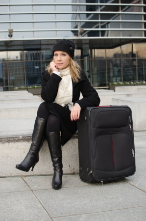 young woman with luggage