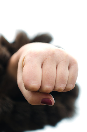Aggressive fist of woman Stock Photo - 24179593