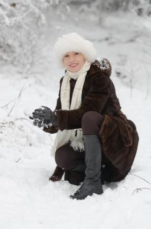 Young woman playing with snow photo