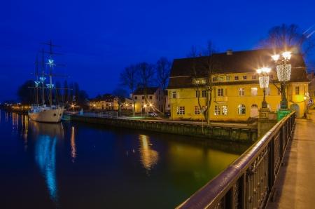 Klaipeda  Lithuania  at night  Old Town and Dane river  Ship Meridianas, 1948, the symbol of Klaipeda city Stock Photo