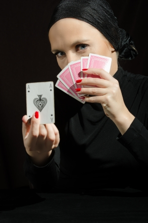 Woman in black with playing cards photo