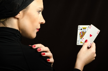 Woman in black with playing cards  black jack pair  photo