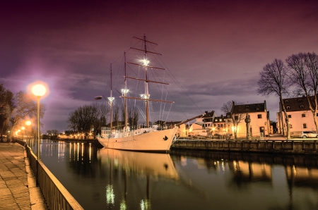 Klaipeda  Lithuania  in the evening  Old Town and Dane river  Ship Meridianas, 1948, the symbol of Klaipeda city