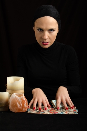 divination: young woman with divination cards
