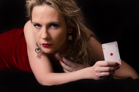 Woman in red with playing card Stock Photo
