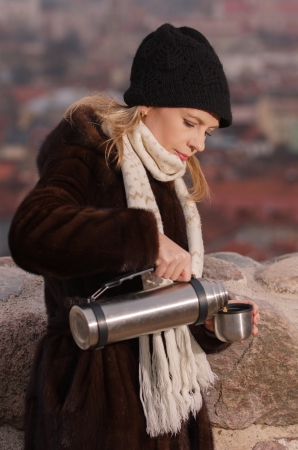 Young woman drinking coffee in Vilnius, Lithuania Stock Photo