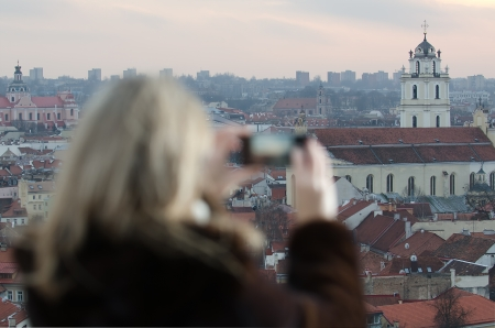 Young woman photographing city of Vilnius, Lithuania photo
