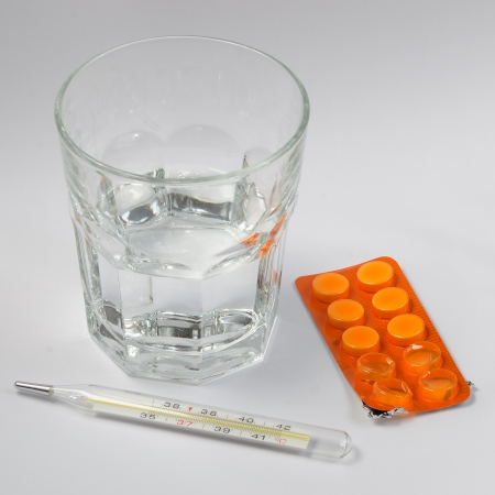Thermometer, pill and glass of water Stock Photo - 25449371
