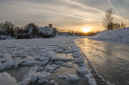 Vilnius  Lithuania  in the sunset of winter  Ice on Neris river   Gediminas Hill and Upper Castle  photo