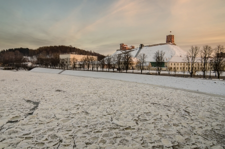 Vilnius  Lithuania  in the winter  Ice on Neris river   Gediminas Hill and Upper Castle  photo