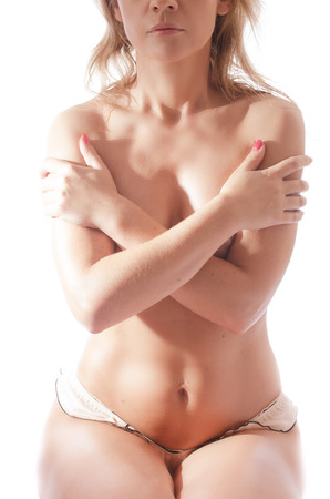 Young topless girl on isolated white background photo