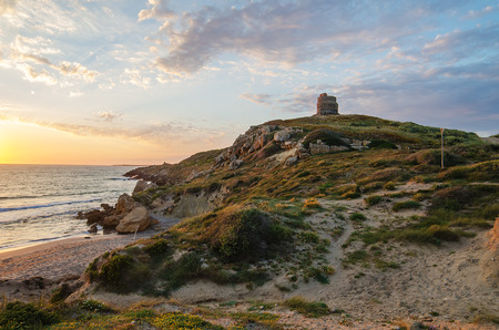 Sunset in San Giovanni di Sinis, Sardinia, Italy  Spanish Tower of San Giovanni  Cape San Marco photo