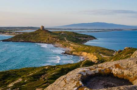Sunset in San Giovanni di Sinis, Sardinia, Italy  Spanish Tower of San Giovanni  Cape San Marco 스톡 콘텐츠