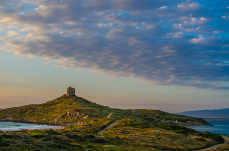Sunset in San Giovanni di Sinis, Sardinia, Italy  Spanish Tower of San Giovanni  Cape San Marco photo