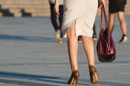 Legs of woman in the street