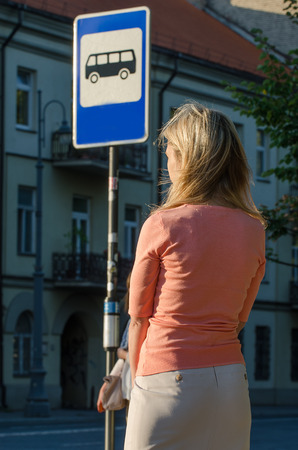 motorbus: Sexy Woman waiting for the bus