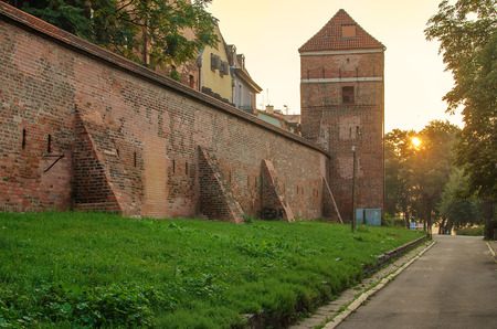 defensive: Old Town in Torun, Poland in the sunrise. Defensive wall