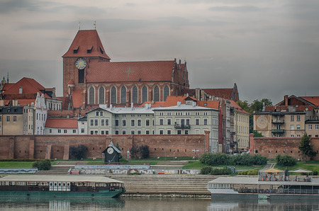 Old town of Torun (Poland) in the sunset. The view from Vistula river