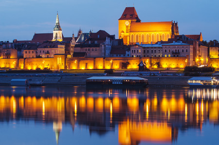 Torun (Poland) at night. The cathedral. The view from Vistula river