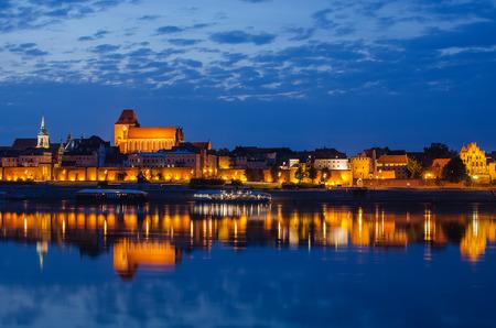 Torun (Poland) at night. The view from Vistula river Stock Photo