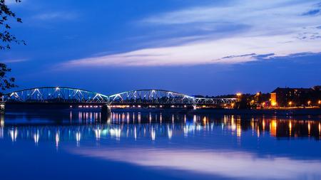 Marshall Jozef Pilsudski Bridge (1934) over the Vistula river  (Torun, Poland) in the sunset