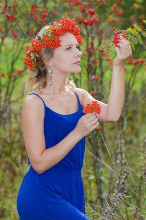 sorbus: Young woman with rowan (sorbus, mountain ash) crown