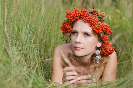 sorbus: Young woman with rowan (sorbus, mountain ash)