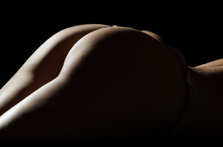 nude black women: Parts of the body of young caucasian woman on black  background