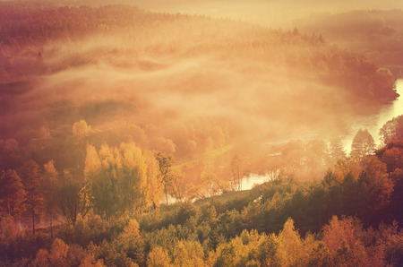 Fog over Neris river in Lithuania next to Vilnius City photo