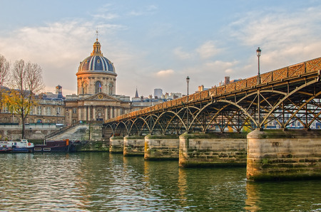 Seine river and Old Town of Paris (France) in the sunrise