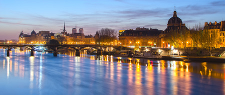 seine: Seine river and Old Town of Paris (France) in the sunrise