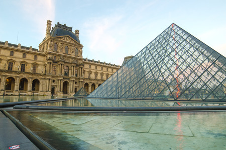 louvre pyramid: Paris (France). Louvre museum in the sunrise. Pyramid