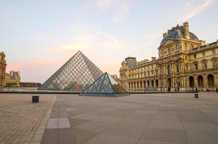 Paris (France). Louvre museum in the sunrise. Pyramid