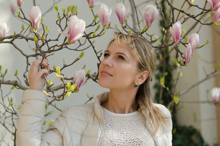 magnolia flowers: Young woman with magnolia flowers