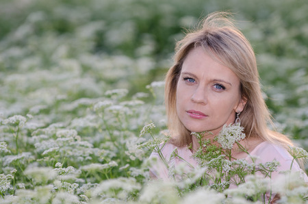 Young woman in the caraway, cumin field Stock Photo