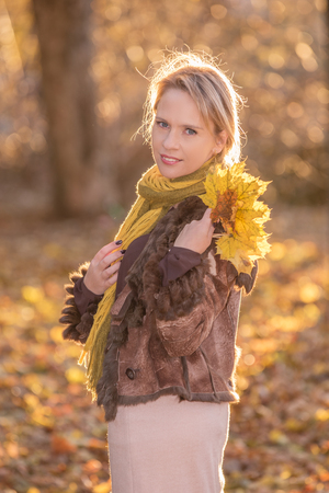 sexy woman standing: Sexy woman standing outdoor in the autumn