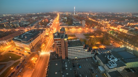wide angle lens: Representative aerial picture of Klaipeda, Lithuania in autumn sunset, taken with wide angle lens. Lights of Liepu street. Stock Photo