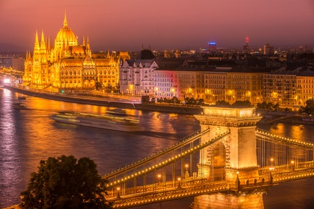 szechenyi: Aerial night view of Budapest, capital city of Hungary. The Szechenyi Chain Bridge. The Hungarian Parliament Building