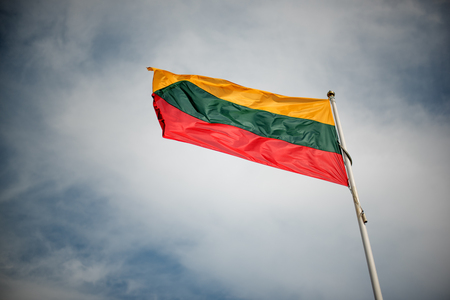 polity: Flag of Lithuania over the Tower of Gediminas