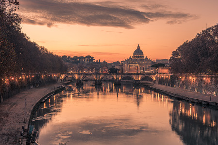 rome: Rome, Italy: St. Peters Basilica, Saint Angelo Bridge and Tiber River in the sunset Stock Photo