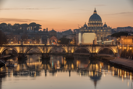 Rome, Italy: St. Peters Basilica, Saint Angelo Bridge and Tiber River in the sunset Stock Photo
