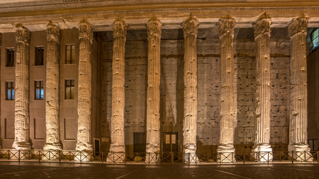 Rome, Italy: columns of Hadrians Temple, Temple of Neptune, in Piazza di Pietra at night