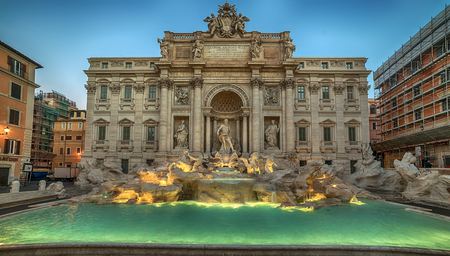 Rome, Italy: The Trevi Fountain, Italian: Fontana di Trevi, in the morning. It is designed by Italian architect Nicola Salvi and completed by Pietro Bracci. The largest baroque fountain in the city. Stock Photo